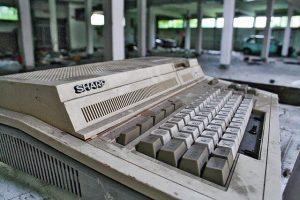 "Old ""Sharp"" computer keyboard abandoned in a parking garage"