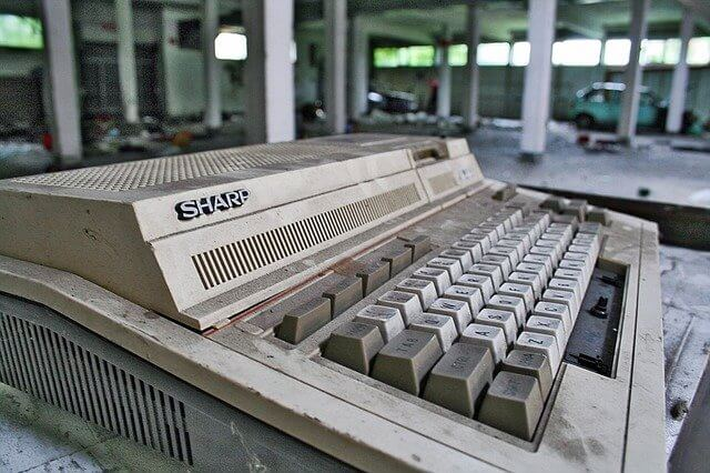 "Old ""Sharp"" computer keyboard abandoned in a parking garage"
