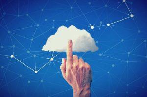 Finger touching cloud against blue, digital background