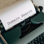 """Typewriter with a paper that says """"Domain Search"""""""
